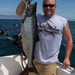 This Lake Ontario salmon made Ron work up a sweat when it hit a Prochip flasher and fly on 500 feet of copper