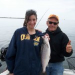 "Leeanne with one of 8 sublegal landlocked salmon boated aboard the ""Fish Doctor"" this season."